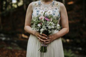 bride with floral bouquet