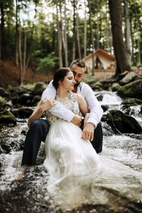 Bride and groom in stream